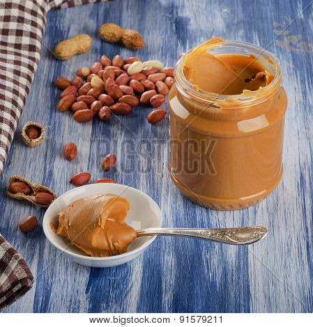 Peanut Butter In A Spoon  With Peanuts.