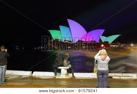 Tourists Brave The Rain On Opening Night Vivid Sydney