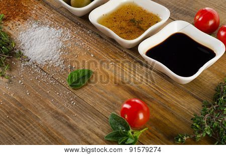 Dressing Ingredients On  Rustic Wooden Background.