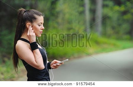 Healthy Lifestyle Sporty Woman With Headphone Jogging In Beautiful Nature Area
