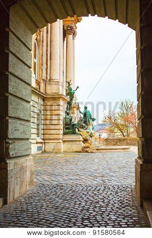 View through the arch of Matthias Fountain in Royal Palace, Budapest, Hungary.