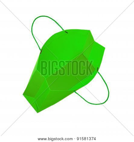 Bright Green Gift Bag Falls Through The Air On An Isolated White Background