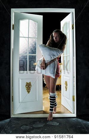 Beautiful Girl In The Doorway With A Pillow