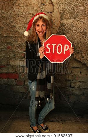 Woman Holding A Stop Sign