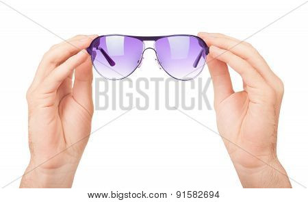 Male Hand Holding Glasses. Isolated On White