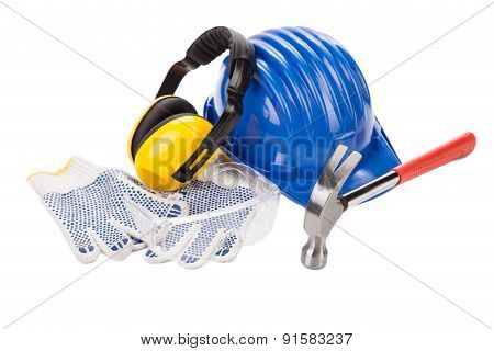 Hard hat ear muffs and hammer.