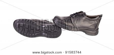 Black shoe sole and side view.