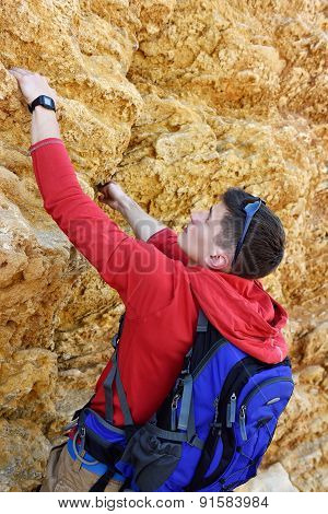 Tourist Climbing Outdoor Wall