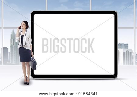 Female Employee And Empty Board