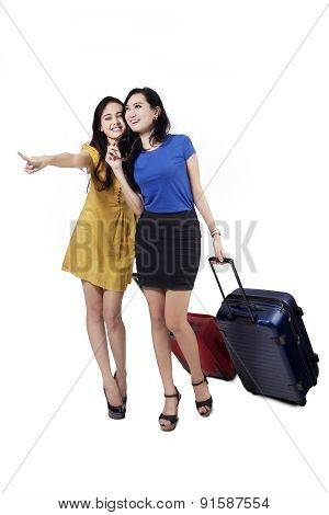Two Girls Carrying Luggage In Studio