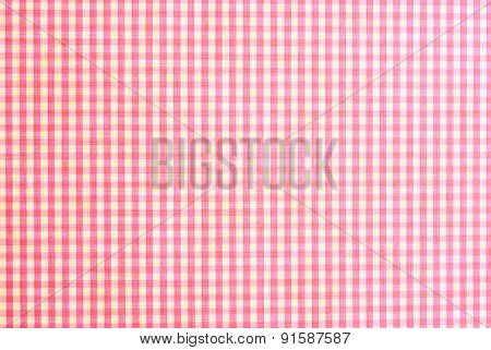 checkered red carpet design on textured paper background