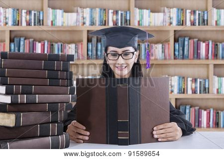 Young Bachelor Studying In Library