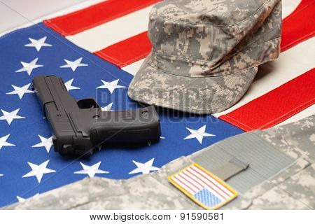 Usa Flag With Handgun And Us Army Uniform Over It