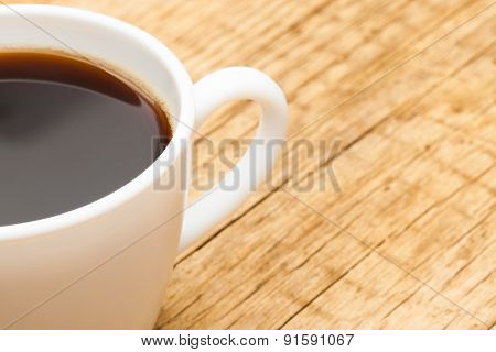 Neat Cup Of Black Coffee On Old Wooden Table