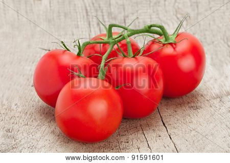 Red Tomatoes On Rustic Wooden Table - Studio Shot