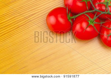 Bunch Of Red Tomatoes On Wooden Table - View From Top