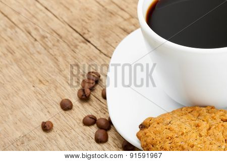 Cup Of Black Coffee With Cookies On Old Wooden Table