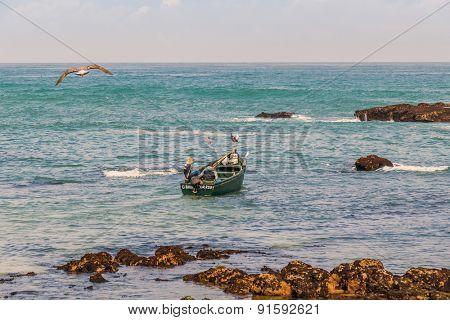 OUALIDIA, MOROCCO, APRIL 6, 2015: Fishermen go to sea in fishing boat