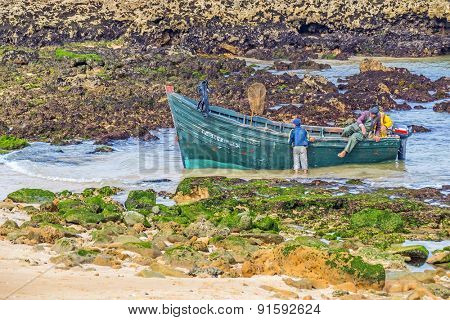 OUALIDIA, MOROCCO, APRIL 6, 2015: Fishermen prepare their boat to go fishing
