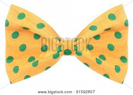 Hair bow tie yellow with green dots