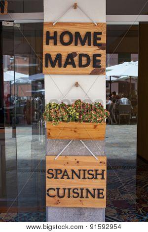 Home made spanish cuisine sign on entrance of restaurant