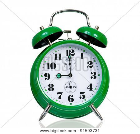 Big green alarm clock, isolated on white