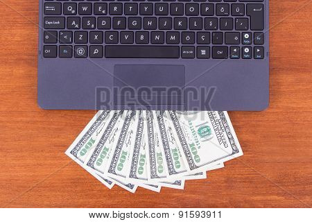 Laptop Detail And Banknotes