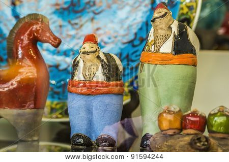 ceramic figures of Turkish men in their national costumes