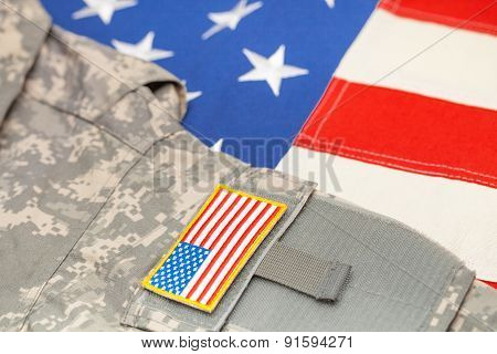 Usa Flag With Us Army Uniform Over It - Studio Shot