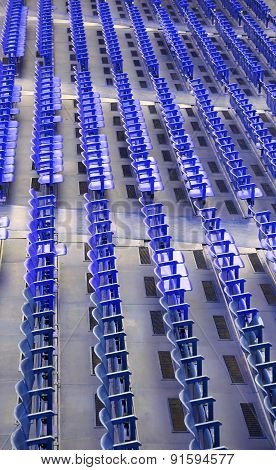 Empty Blue Seats In The Stands Before