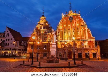 Riga Town Hall Square, House of the Blackheads and St. Roland Statue illuminated in the evening twilight, Riga, Latvia