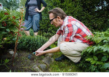 woman make her husband work in garden