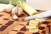 image of leek  - the leek cut by means of a knife and garlic segment on a chopping board - JPG