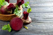 pic of basil leaves  - Beets and Basil leaves on wooden table - JPG