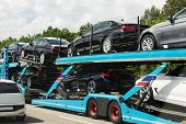 picture of car carrier  - transportation of brandnew cars on a auto transporter highway traffic delivery ex works - JPG