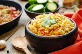 picture of saffron  - saffron rice with vegetables and cilantro on a dark wood background - JPG
