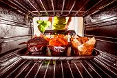foto of oven  - Baking muffins in the oven - JPG