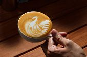 picture of latte  - Making of cafe latte art on the wooden table - JPG