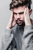 pic of pullovers  - Portrait of a young man in gray pullover - JPG