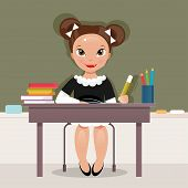 image of schoolgirls  - Schoolgirl in classroom sitting at a desk and writing - JPG