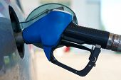 foto of gasoline station  - The car is fueled with gasoline at a gas station - JPG