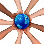 stock photo of trade  - Global connections and globalization concept as a connected business network of multiethnic people holding a world map planet for worldwide cooperation and trade agreement unity - JPG