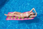 picture of mattress  - beautiful girl floating on a mattress in the sea or swimming pool - JPG