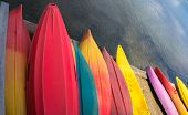 pic of pier a lake  - many colored kayaks on pier ready for  use on the lake - JPG