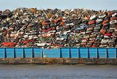 picture of barge  - Scrap metal barge loaded with crushed cars for recycling - JPG