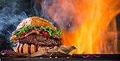 picture of hamburger-steak  - Delicious burger with fire flames - JPG
