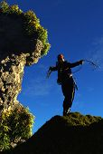 picture of hook  - Climber throwing the hook in the mountains - JPG