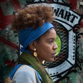 picture of street-art  - young afro woman profile in a urban street art scene - JPG