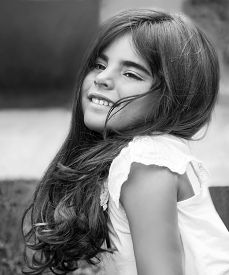 stock photo of little girls photo-models  - Fashion black and white photo of a beautiful little girl having fun in the park - JPG