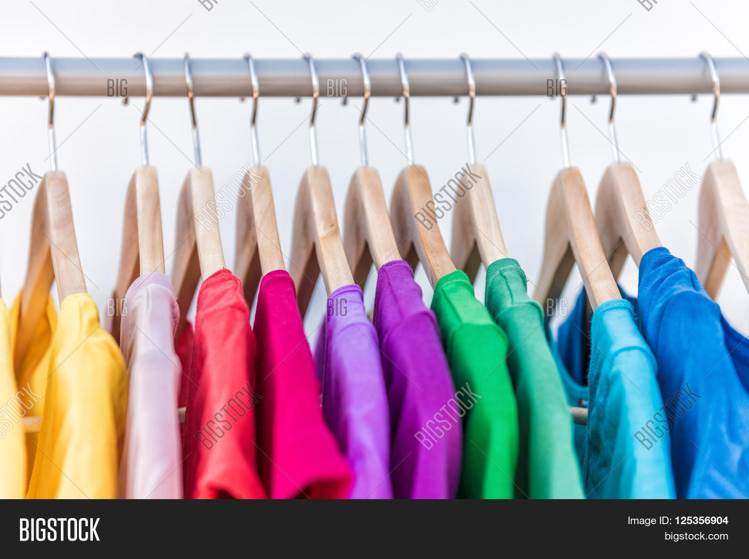 Fashion Clothes On Clothing Rack   Bright Colorful Closet. Closeup Of  Rainbow Color Choice Of